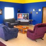 Large Screen TV and Couches for the Party Zone